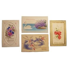 Early 20th century birthday postcards with raised designs