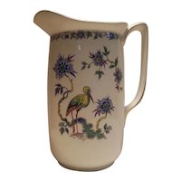 Large transferware pitcher with bird scene