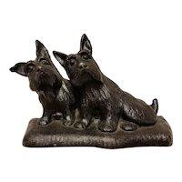 Cast iron scottie dogs doorstop