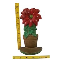 Cast iron poinsettia doorstop made by Hubley