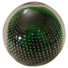 Pilgrim glass controlled bubbles dark green paperweight