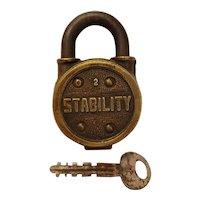 Working vintage brass stability padlock with key