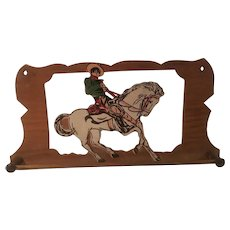 1940 Era wooden child's tie rack featuring the lone ranger on silver