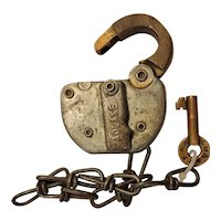 C M & ST P railroad padlock with key