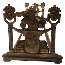 Bronze colored Expandable bookrack featuring 16th century man with sword