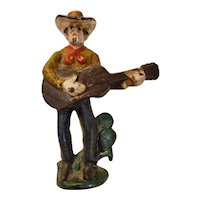 Cast iron cowboy with guitar bottle opener