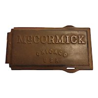 Cast iron tractor or implement lid marked McCormick
