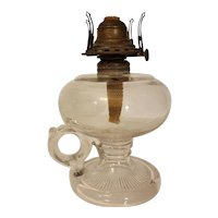 Antique oil lamp with finger loop and queen anne burner