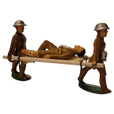 Manoil stretcher bearers carrying wound man on stretcher