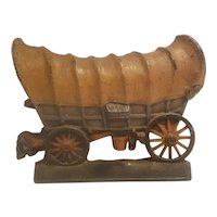 cast iron covered wagon doorstop made by Creations Company in 1930