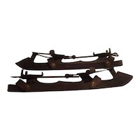 Adjustable antique clip on ice skates with original leather and brass blade covers
