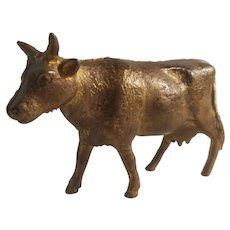 A C Williams cast iron cow bank