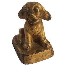 Cast iron grinning pup paperweight
