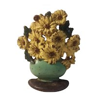 Daisy bowl cast iron doorstop