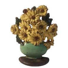 Daisy bowl cast iron doorstop