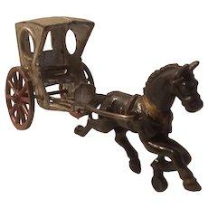 Horse drawn cast iron hansom cab