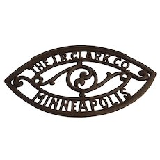 J R Clark Co trivet, cast iron
