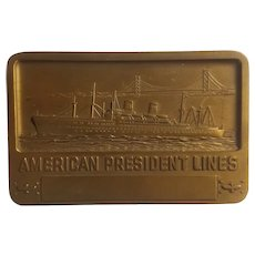 Bronze paperweight advertising American President Lines