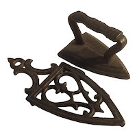 Toy cast iron trivet and iron