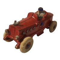 Cast iron boat tail racer with driver