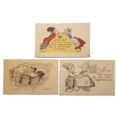 Three Dutch themed postcards