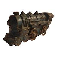 Small cast iron train engine