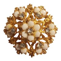 Florenza gold tone and rhinestone brooch