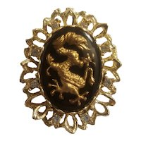 Black and gold tone stylized dragon brooch
