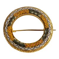Mosaic wreath brooch in gold tone setting.