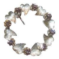 Silver tone leaves and rhinestones wreath brooch