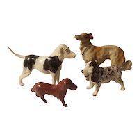 4 Lead dog figurines