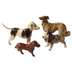 4 Lead dog figurines