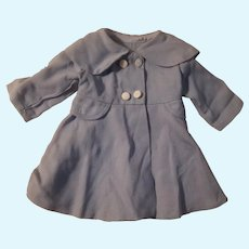Blue doll coat with white buttons