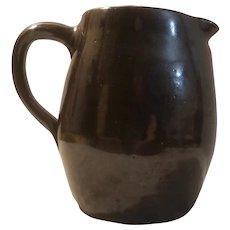 Handmade stoneware pitcher dated 1912