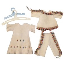 Leather, beaded doll dress and fringed doll outfit