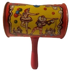 Tin litho noisemaker with wooden handle