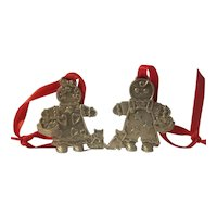 Matching silver colored ginger bread boy and girl ornaments