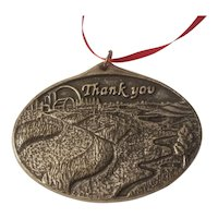 Silvertone ornament stamped with 'thank you' and farm scene