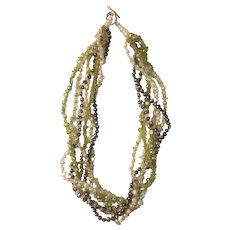 Multi strand simulated pearl and peridot chip necklace