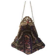 Beaded purse with ornate silver colored closure