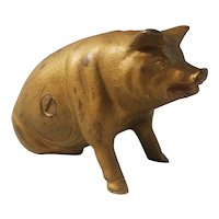 Cast iron sitting pig bank