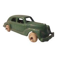 Small cast iron sedan