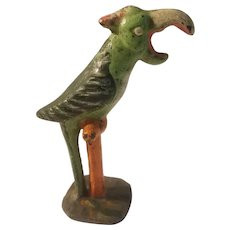 Cast iron parrot on perch bottle opener