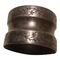 Napkin ring with etched vine decoration
