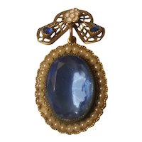 Blue faux gem with simulated pearls, filigree and white enamel