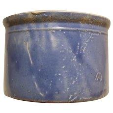 Small blue crock with interesting glaze