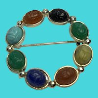 Vintage Gold Tone Circle Brooch with Colorful Carved Gemstone Scarabs