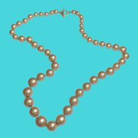 "Vintage 26"" MONET Individually Knotted Graduated Tan Faux Pearl Necklace"