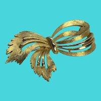 Vintage J.J. Brushed Gold Tone Bow Brooch