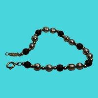 """Napier 7.5"""" Gold Tone, Faux Pearl & Purple Glass Bead Bracelet"""